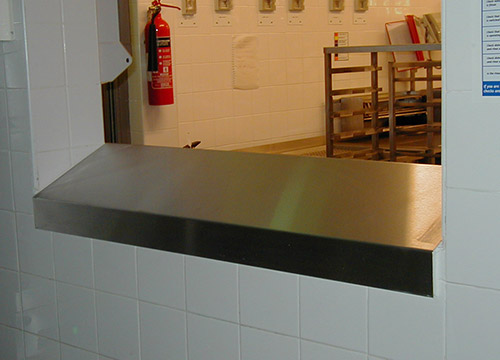 bespoke designed sloping shelf between the bakery and washing areas